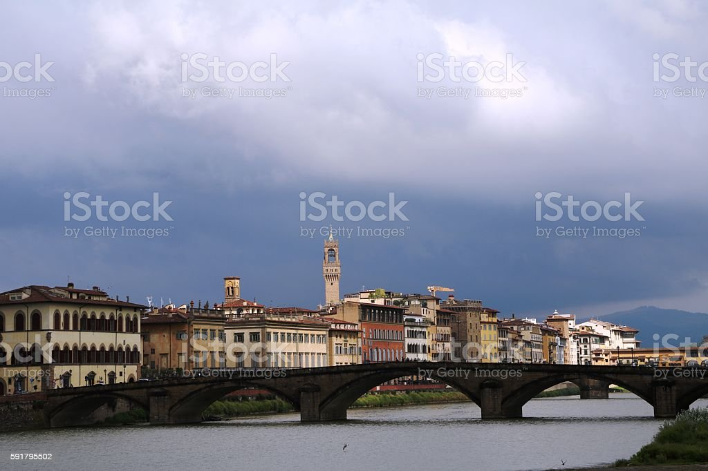 Storm clouds over Ponte alla Carraia and River Arno, Florence stock photo