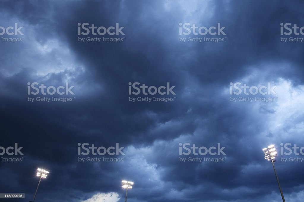 Storm Clouds Over Stadium Lights royalty-free stock photo