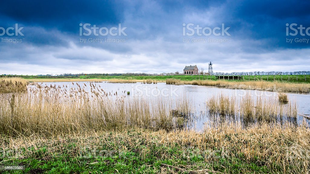 Storm clouds over the old port of schokland, Netherlands stock photo