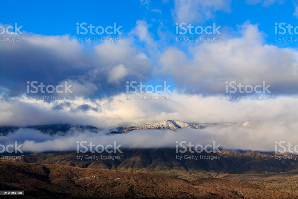Storm clouds traveling low over the Mogollon Rim Plateau stock photo