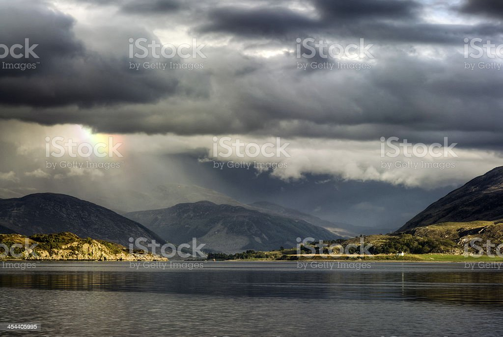 Storm clouds with rainbow, Loch Broom, Highlands, Ullapool. Highland, Scotland stock photo