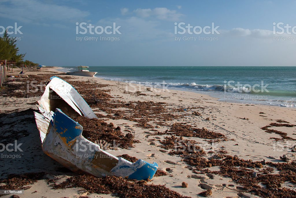 Storm damaged Fishing Boat Skiff on Isla Blanca Cancun Mexico stock photo