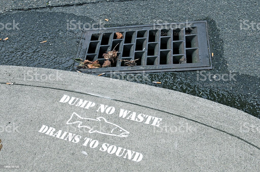 Storm drain on hill above Puget Sound in Seattle WA royalty-free stock photo