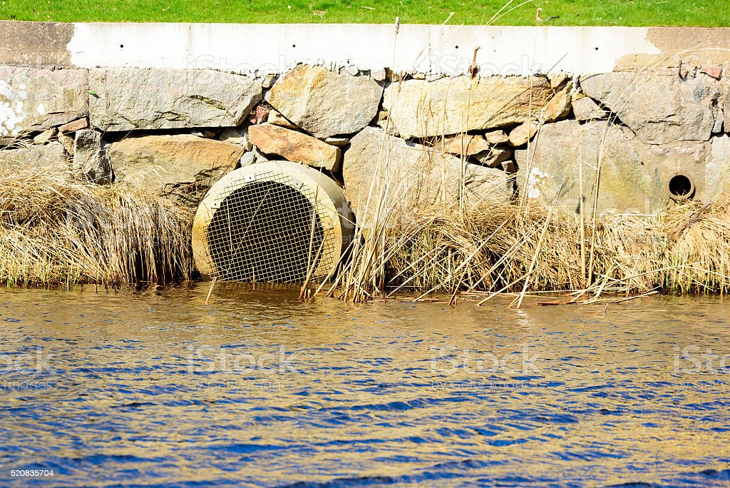 Storm drain outlet stock photo