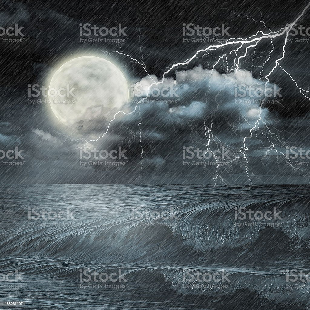 storm evening on ocean and the moon royalty-free stock photo