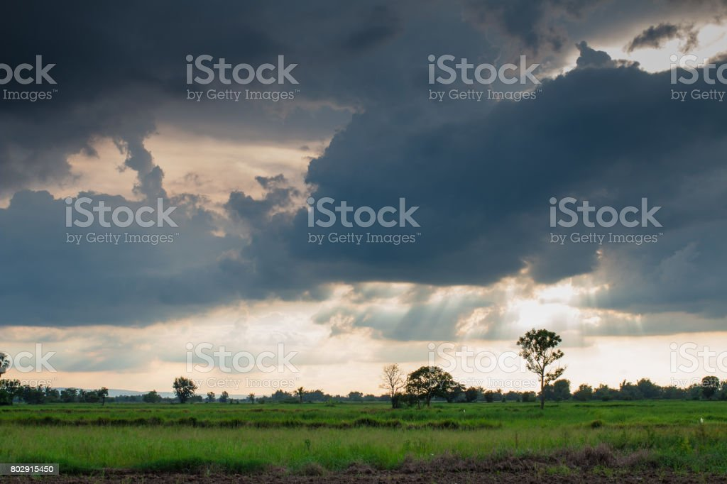 Storm formed Along with the sun through the clouds.dark tone stock photo