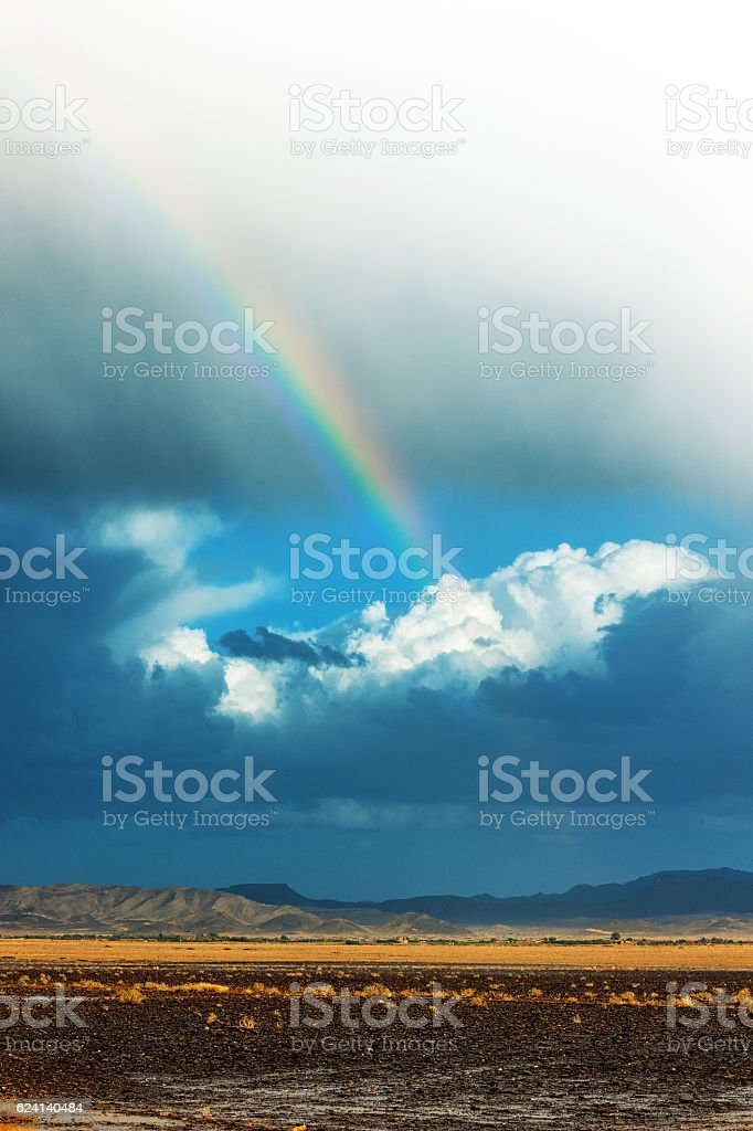 Storm in the Sahara desert in the afternoon,rainbow,Morocco stock photo