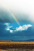 Storm in the Sahara desert in the afternoon,rainbow,Morocco