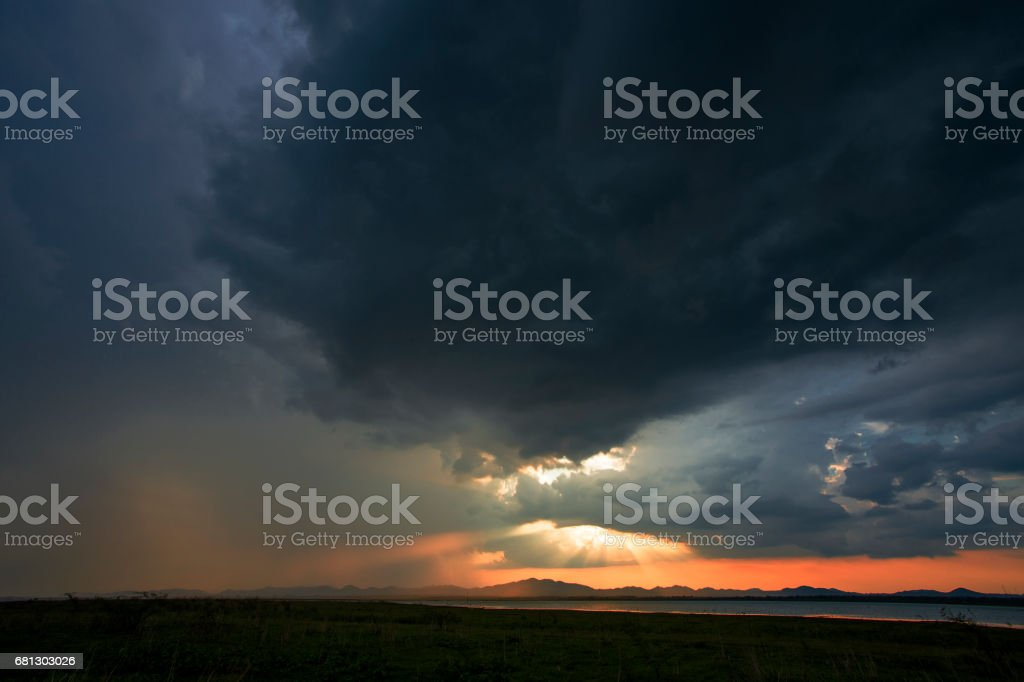 A storm is coming rain cloud are over the mountain and lake on the...