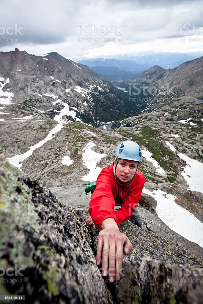 Storm looming behind a female rock climber in Colorado royalty-free stock photo