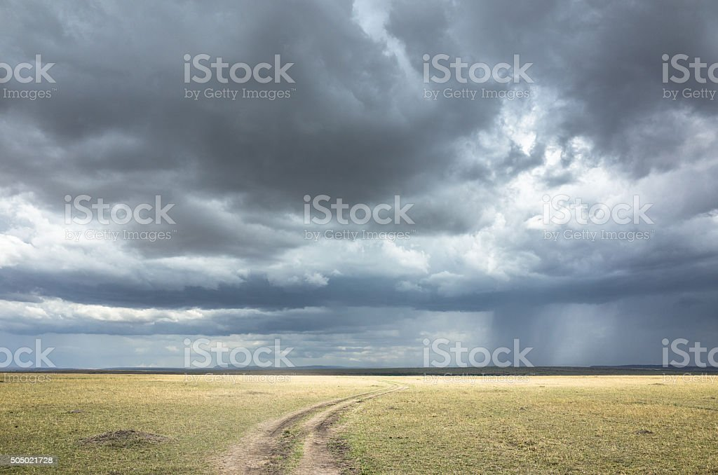 Storm on the horizon. Winding roads and dark clouds ahead. stock photo