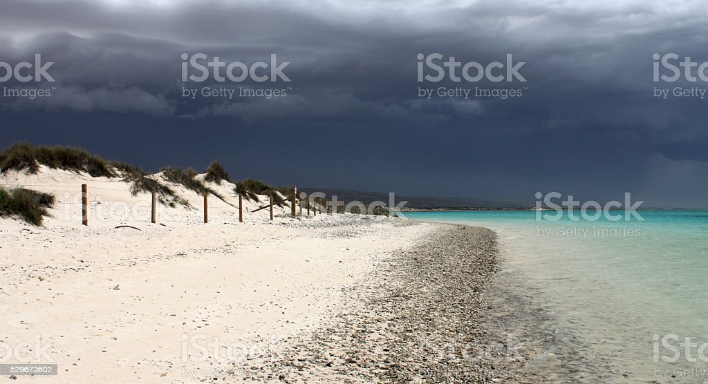 Storm over blue beach stock photo