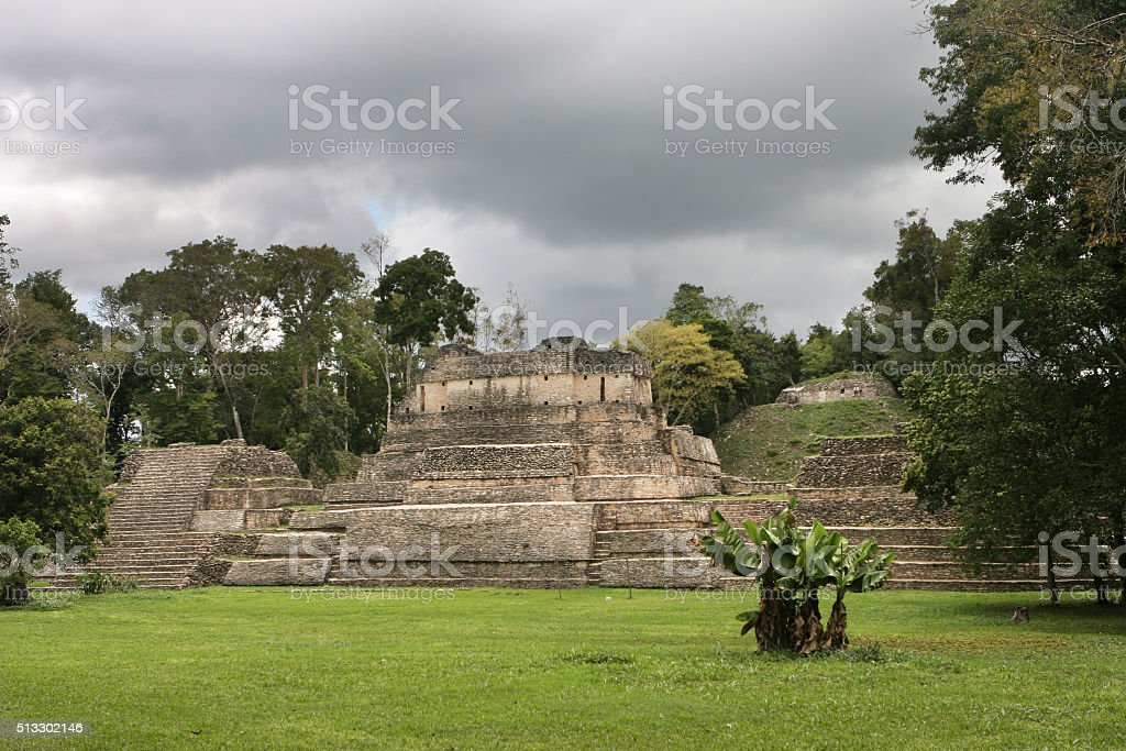 Storm over Caracol A-Group Maya pyramid temple Belize Central America stock photo