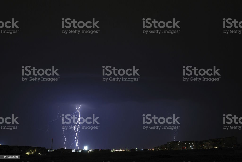 storm over the city lights royalty-free stock photo