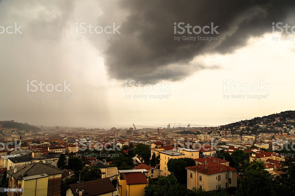 storm over the city of Trieste stock photo