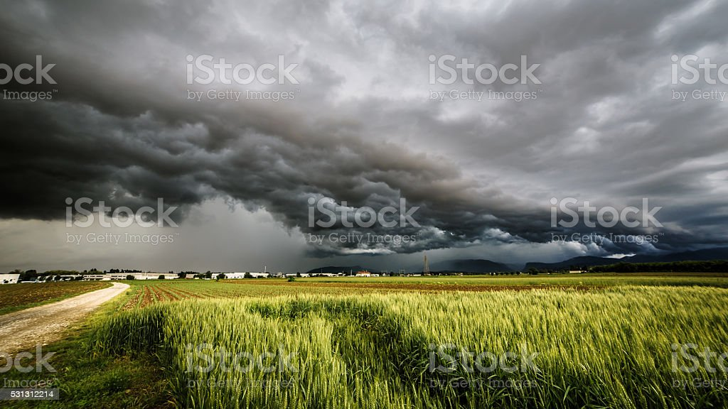 storm over the fields stock photo