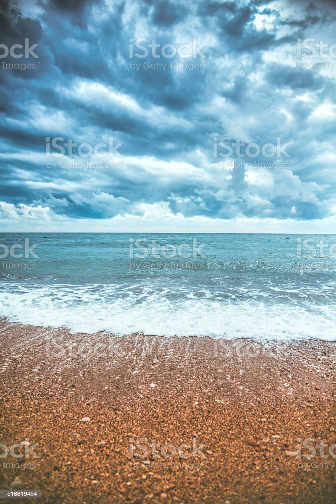 Storm over the sea with heavy clouds, dramatic sky stock photo