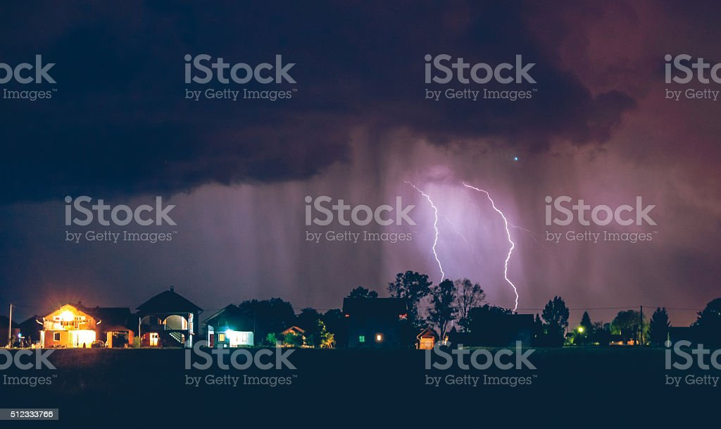 Storm over the village street stock photo