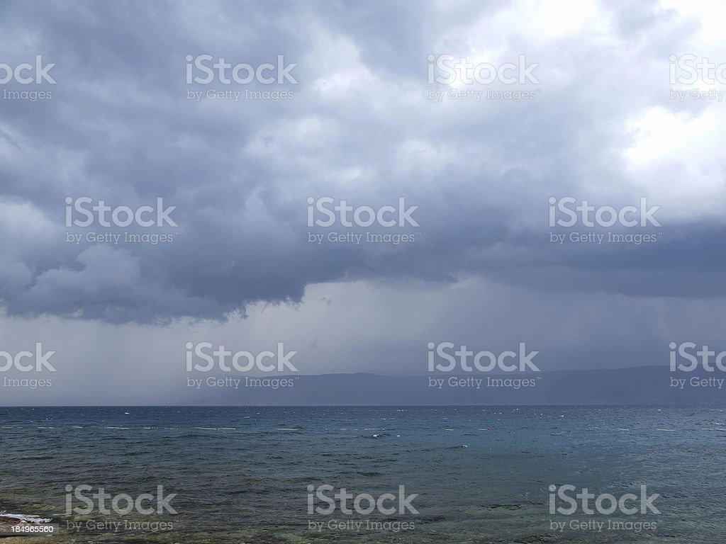 Storm rolling into beach royalty-free stock photo