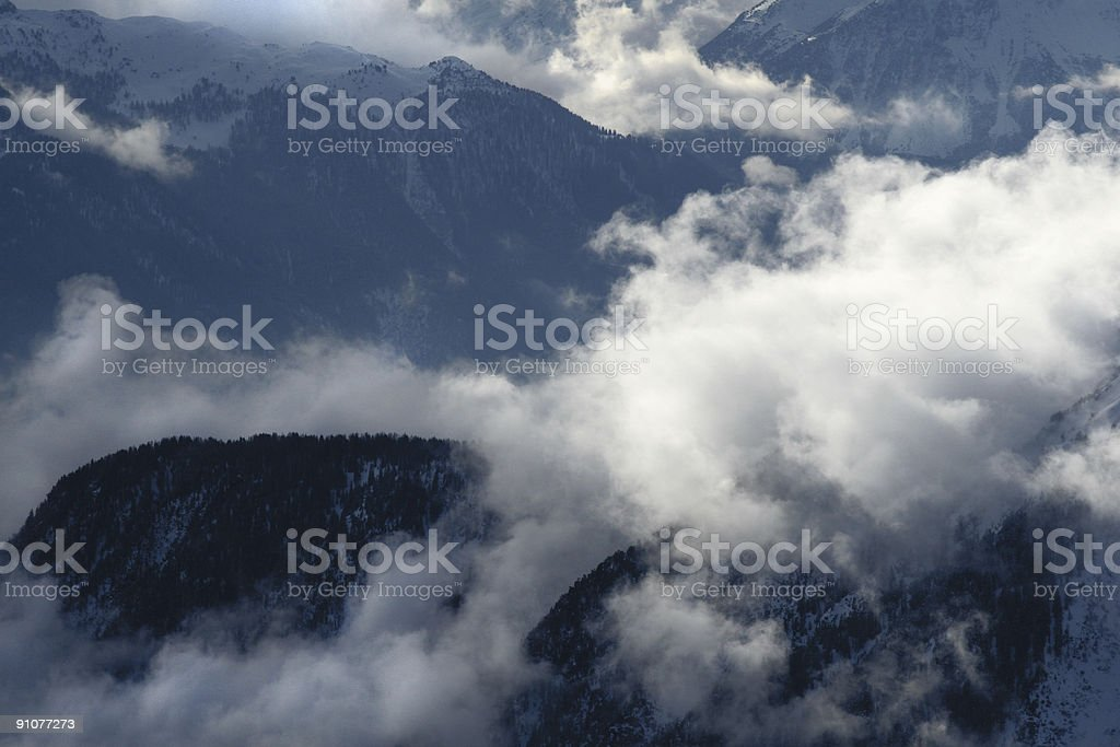 Storm rolling into the mountains stock photo