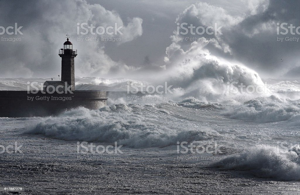 Storm waves over the Lighthouse stock photo