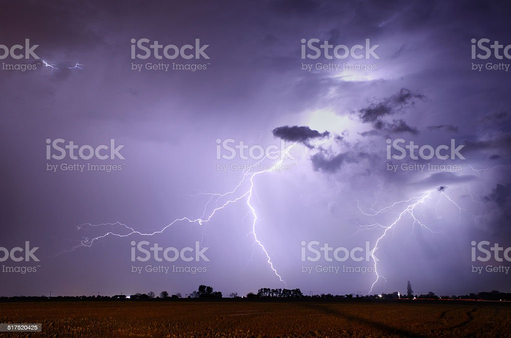 Storm with lightning in landscape stock photo
