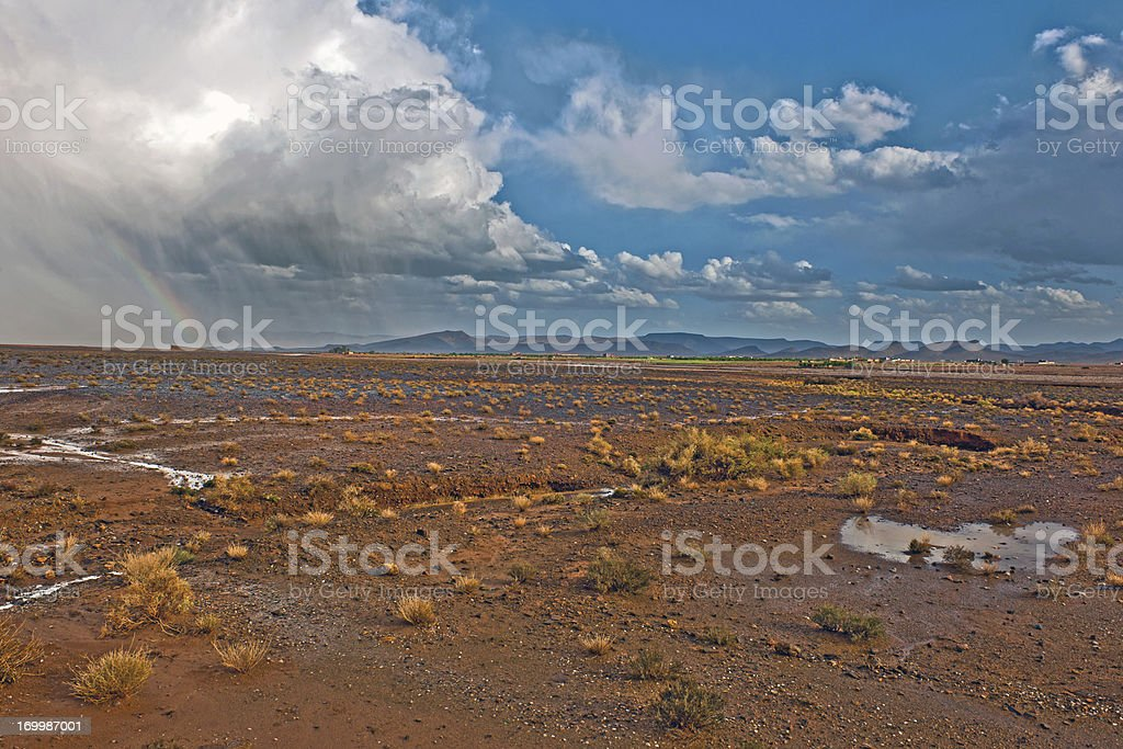 Storm with Rainbow in Desert Morocco Africa royalty-free stock photo