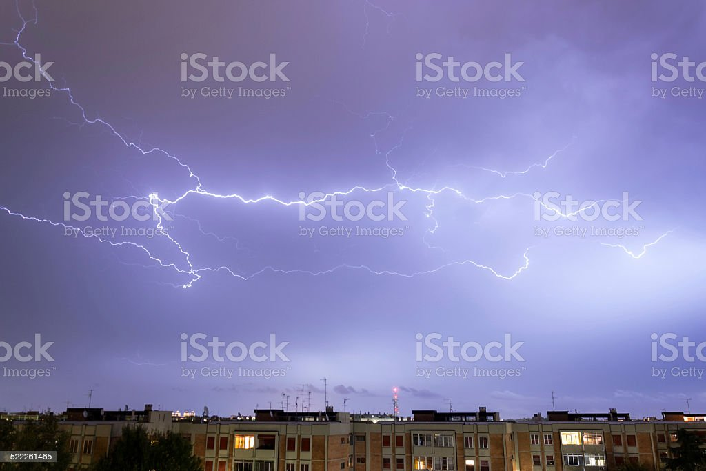 Storm with some lightning strike in the sky stock photo
