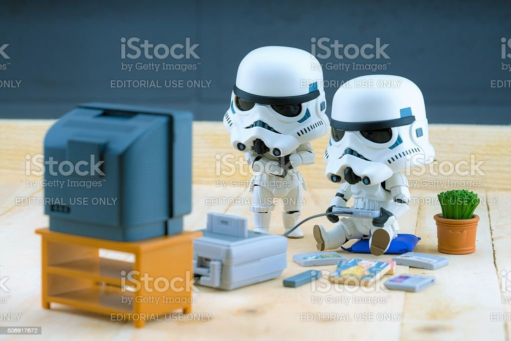 Stormtrooper figure playing the gameboy stock photo