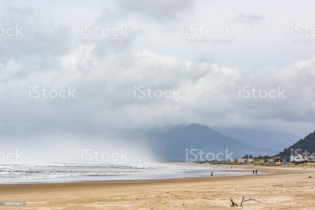 Stormy clouds and rain on ocean beach in Oregon stock photo