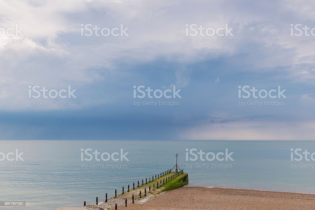 Stormy clouds over a calm sea stock photo