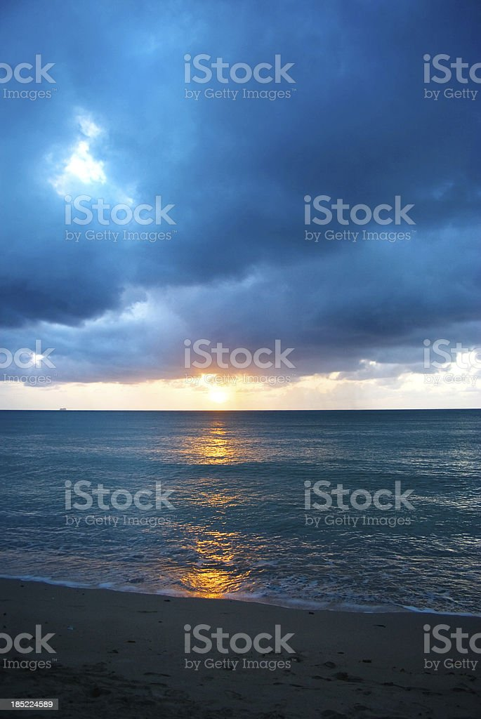 stormy clouds seascape at sunset stock photo