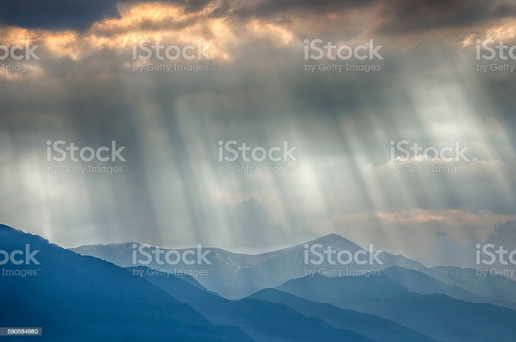 Stormy cloudy sky with sunbeams royalty-free stock photo
