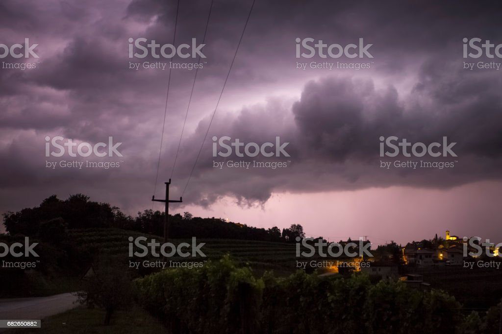 Stormy night falls over the city stock photo
