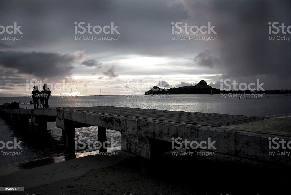 stormy pier with family on vacation stock photo