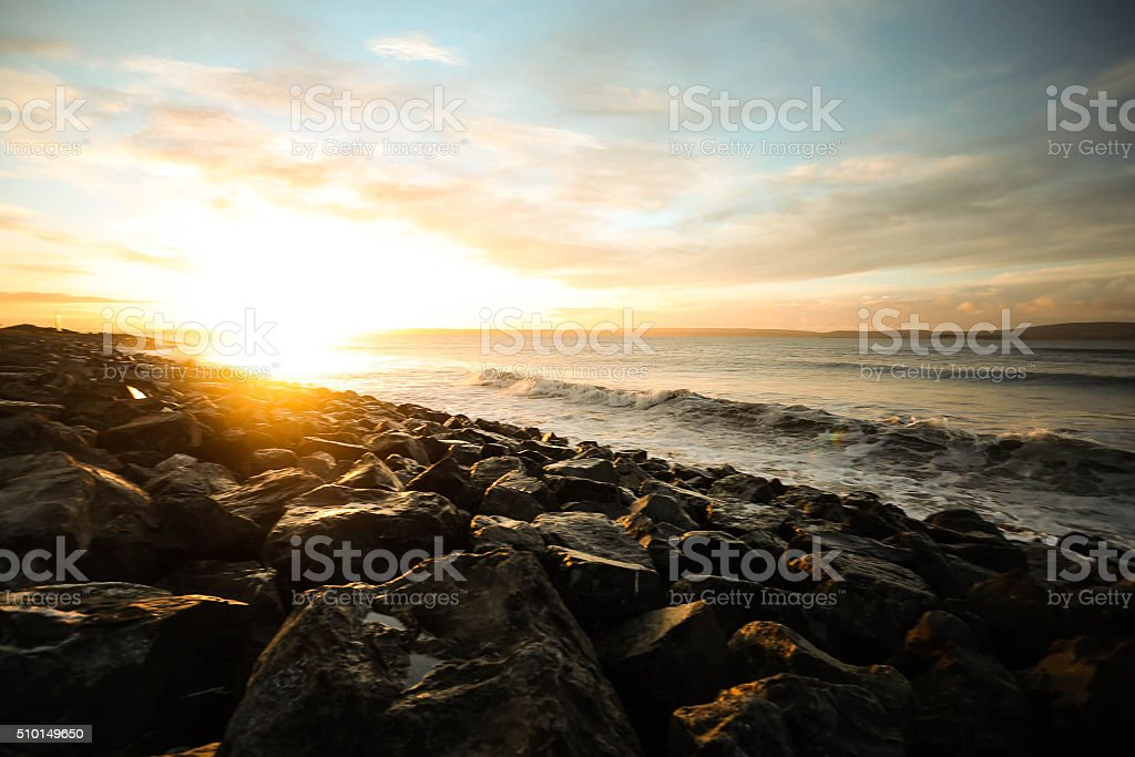 stormy sea at sunrise stock photo