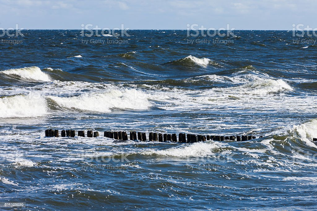 Stormy sea, waves and breakwater stock photo