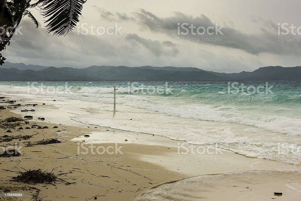 Stormy seas batter a tropical beach during monsoon season royalty-free stock photo