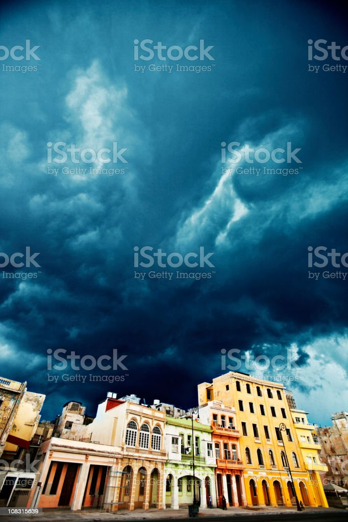 stormy skies over colorful buildings royalty-free stock photo