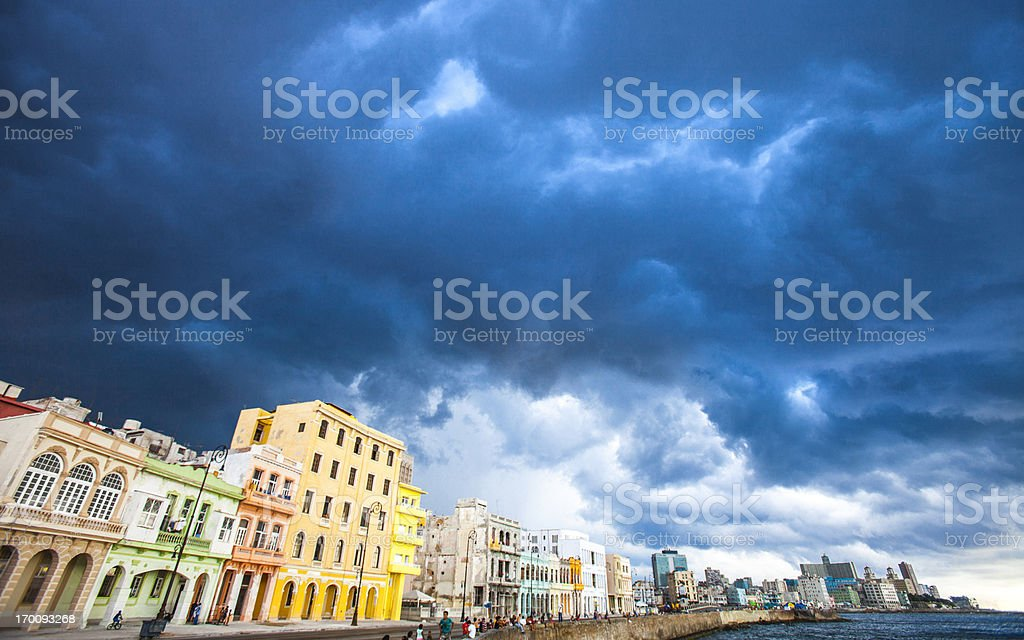 Stormy skies over colorful buildings. stock photo