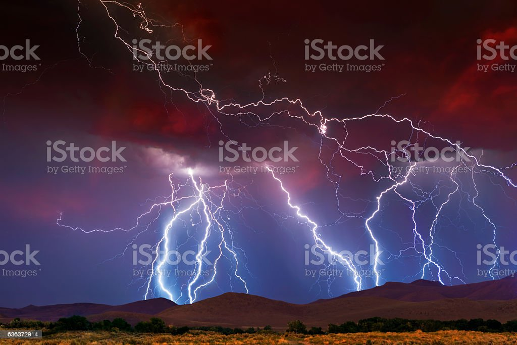 Stormy Skies with multiple lightning strikes stock photo
