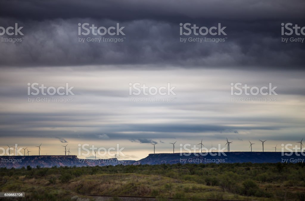 Stormy Sky and Wind Turbines Over West Texas Plain stock photo
