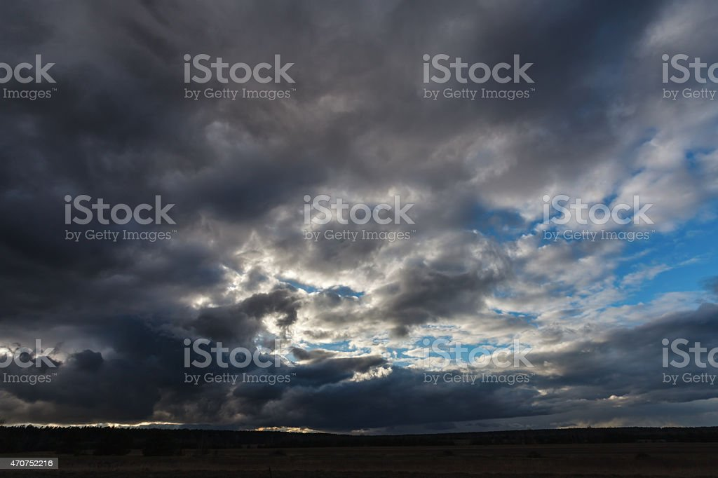 Stormy sky full of clouds stock photo