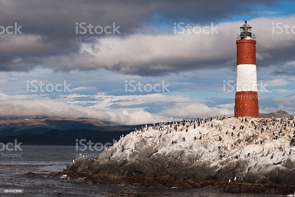 Stormy sky over red and white colored lighthouse stock photo