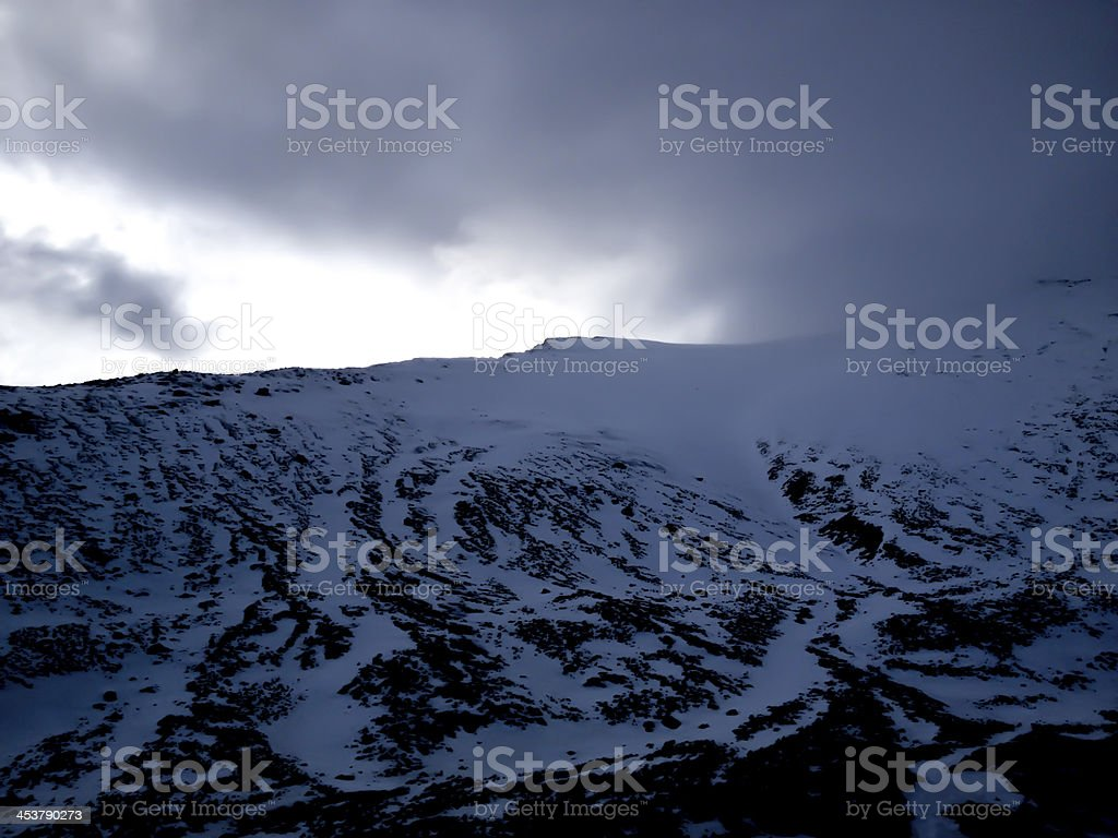 Stormy snowy mountaintop stock photo