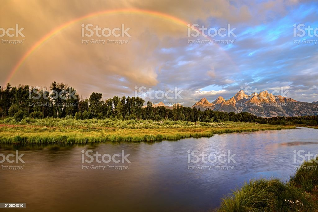 Stormy Sunrise at the Snake River and the Grand Tetons stock photo