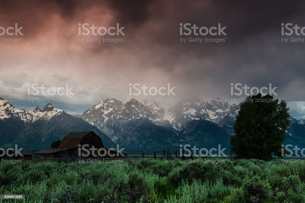 Stormy sunrise in Grand Teton stock photo