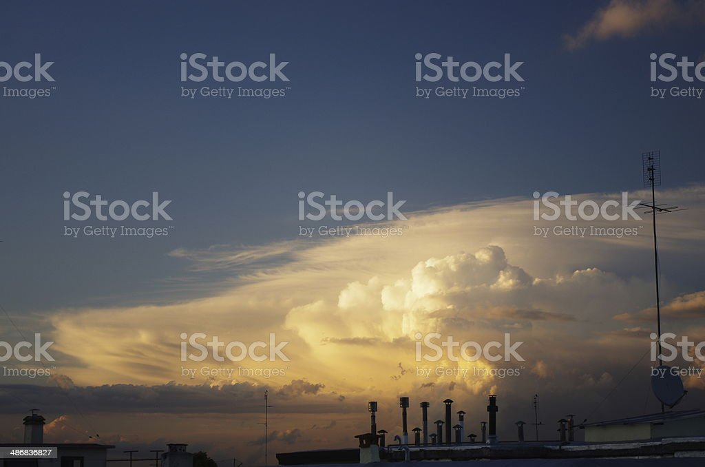 Stormy sunset on the top of the roof stock photo