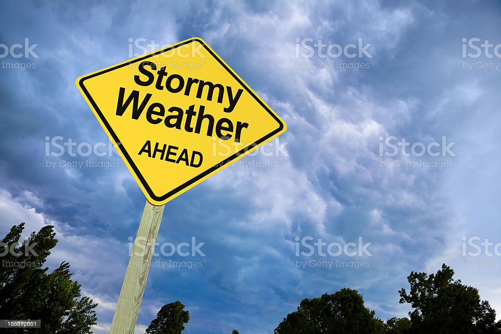 Stormy Weather Ahead Road Sign Against Ominous Dark Sky stock photo