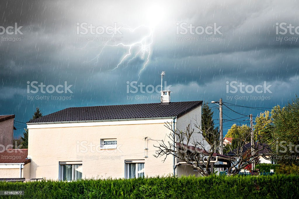 Stormy weather over common houses stock photo